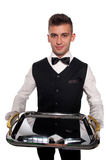 A young boy waiter with a tray Royalty Free Stock Photos