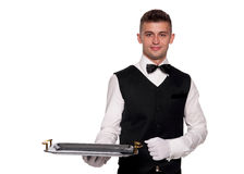 A young boy waiter with a tray Stock Image