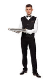 A young boy waiter with a tray Stock Photography