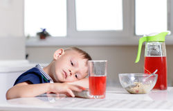 Young boy waiting patiently for his lunch Stock Image