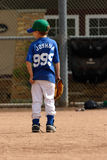 Young boy waiting for play in baseball royalty free stock image