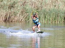 Young boy wakeboarding Stock Image