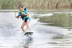 Young boy wakeboarding Stock Photos