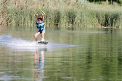 Young boy wakeboarding Stock Images