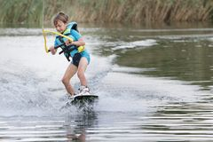 Young boy wakeboarding Royalty Free Stock Photography
