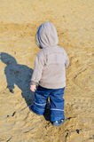 Young boy walking on the beach Royalty Free Stock Image