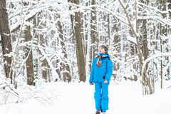 Young boy walking in a snowy winter park Stock Image