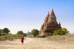 Young boy walking to the temple in Myanmar Royalty Free Stock Images
