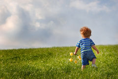 Young  boy walking up a hill Stock Photos