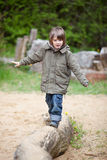 Young Boy Walking On Wood At Park Stock Photos