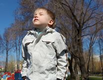 Young boy walks in the park Stock Photo
