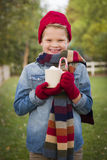 Young Boy in Warm Clothing Holding Hot Cocoa Mug Outside Royalty Free Stock Photos