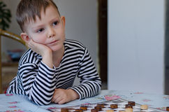 Young boy watching with curiosity Royalty Free Stock Photo