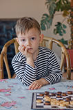Young boy watching with curiosity Stock Images