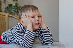 Young boy watching with curiosity Stock Photography