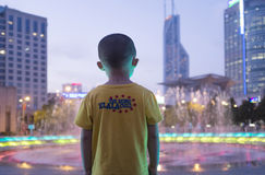 Young boy watching night Shanghai Royalty Free Stock Image