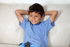 Young boy watching TV. With remote control Royalty Free Stock Image
