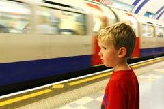 Boy Catching Underground Train Stock Photos