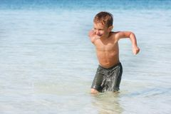 Young boy in water. Young boy playing in water Stock Photography