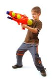 Young boy with water gun. Over white background stock photography