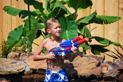 Young boy with water gun Royalty Free Stock Image