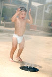 Young boy at a water park Stock Photos