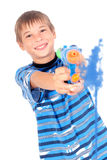 Young boy with water gun. Young boy smiling and having fun with a water gun splashing the screen with water, on white background stock photography