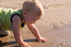 Young boy at the water's edge Royalty Free Stock Photo