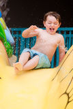 Young boy on water slide Stock Image