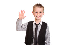 Young Boy Waving at the camera Royalty Free Stock Image