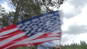 Young boy waving USA flag stock footage