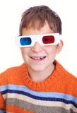 Young boy wearing 3D glasses. Cute young boy wearing 3D glasses isolated over white Royalty Free Stock Images