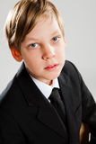 Young boy wearing black suit Royalty Free Stock Image