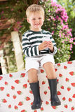 Young Boy Wearing Boots Drinking Milkshake Royalty Free Stock Image