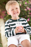 Young Boy Wearing Boots With Milkshake Stock Image
