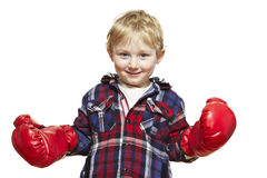 Young boy wearing boxing gloves smiling. On white background Stock Photo