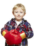 Young boy wearing boxing gloves smiling. On white background Royalty Free Stock Photo