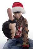 Young boy wearing christmas hat showing thumb. On an isolated white background Royalty Free Stock Photography