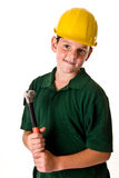 Young boy - future construction worker. A young boy wearing a hard hat and holding a hammer, isolated on a white background Royalty Free Stock Photography