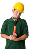 Young boy - future construction worker. A young boy wearing a hard hat and holding a hammer while in thought, isolated on a white background Royalty Free Stock Photos
