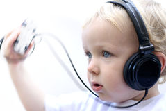 Young boy wearing headphones IV Royalty Free Stock Images