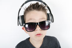 Young boy wearing headphones listening music in Royalty Free Stock Images