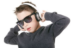 Young boy wearing headphones listening music in Stock Photography