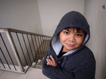 Young boy wearing a hoodie jacket Stock Images