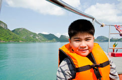Young boy wearing a life jacket Stock Image