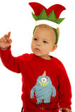 Young boy wearing pajamas and a Christmas elf hat Royalty Free Stock Images