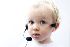 Young boy wearing phone headset II Stock Photos
