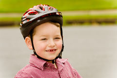 Young boy wearing safety helmet Stock Images