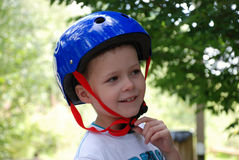 Young boy wearing safety helmet Stock Image