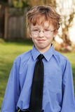 Young boy wearing a shirt and tie outside. stock images